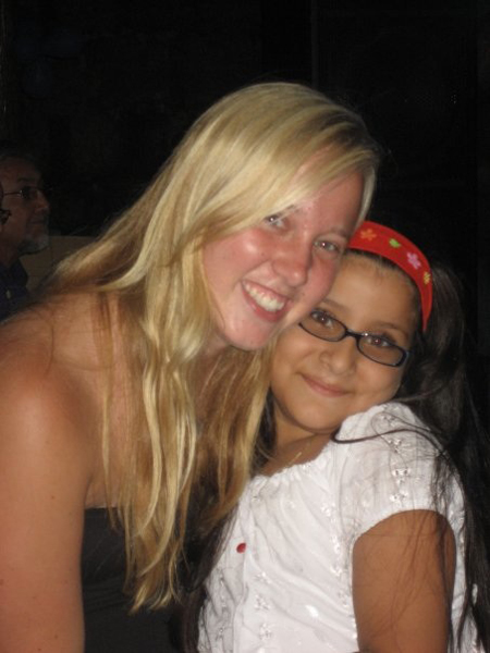 Alli Hawkins and her host sister smile for the camera