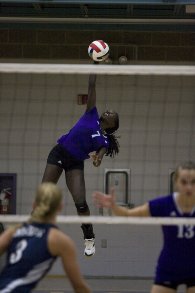 volleyball player spikes ball in game