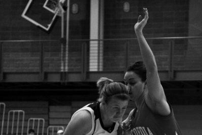 Basketball player drives to basket