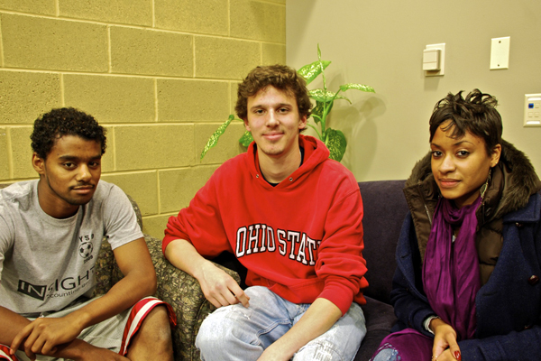 Three student researchers sit in armchairs in a Kratz connector