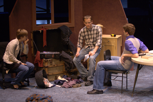 Student actors perform on Umble Center stage in costume