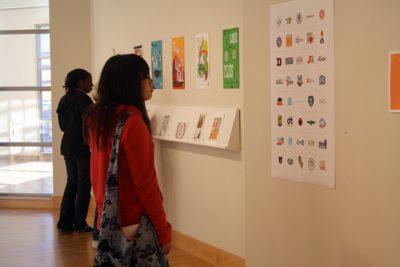 Students look at Mikey Burton's artwork in the Hershberger Art Gallery