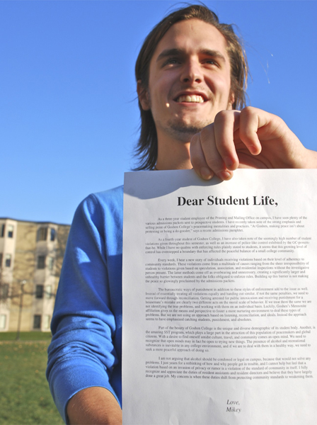 Ruth holds up a letter to student life