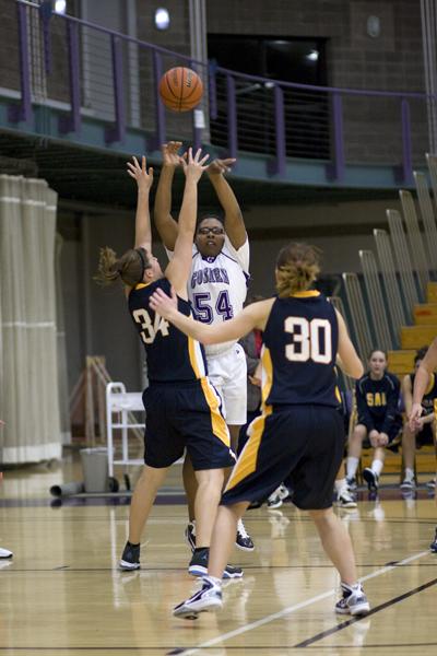 basketball player takes a shot