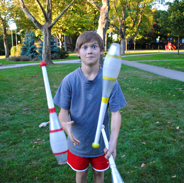 10 year-old Simon Graber-Miller juggles on the Goshen College campus