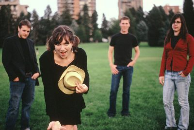 The four members of Rachel Eisenstat & Iron City pose for an outdoor picture