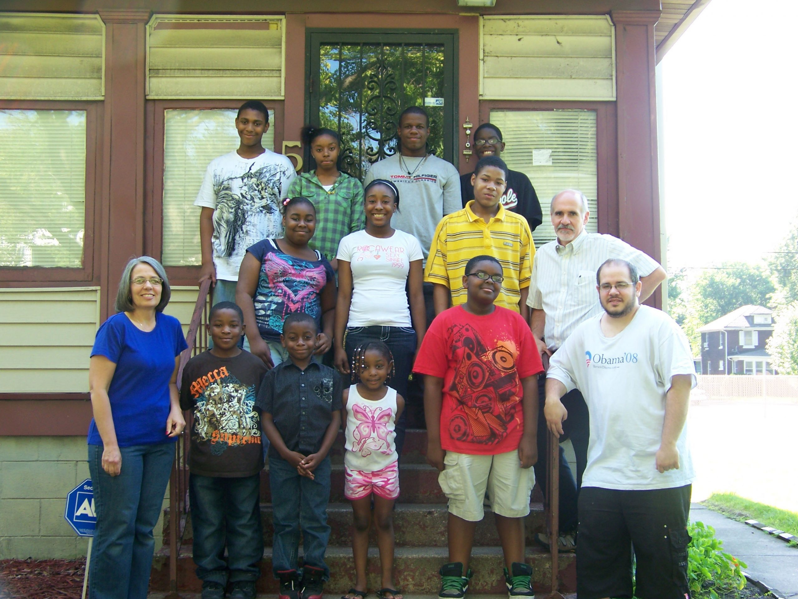 Gary and Gwen Miller with participants in their Urban Faith Works organization in front of the newly renovated center.