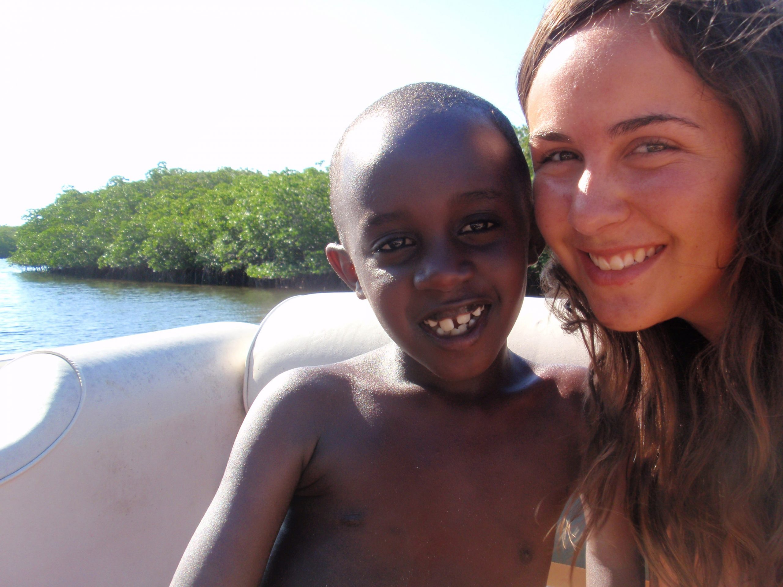 Laura Schlabach in Kenya with young boy