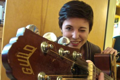 Lauren Treiber poses for a picture with her guitar