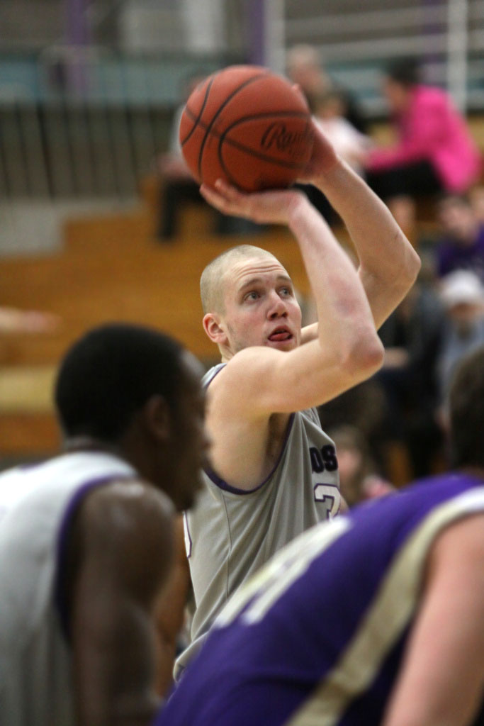 Close-up image of a player on the Goshen men's basketball team preparing to shoot