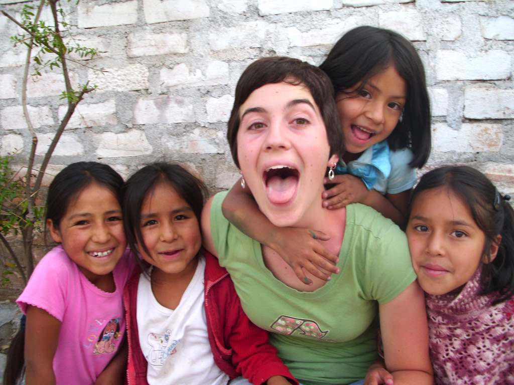 Elizabeth Speigle poses for a picture with four Peruvian children