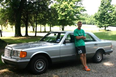 Greg Theissen stands by his car