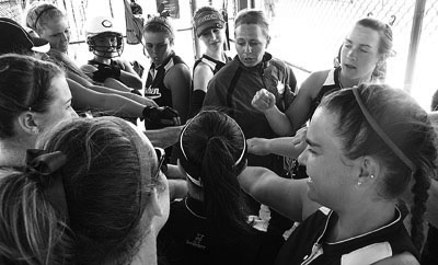 Black and white image of the softball team before a game