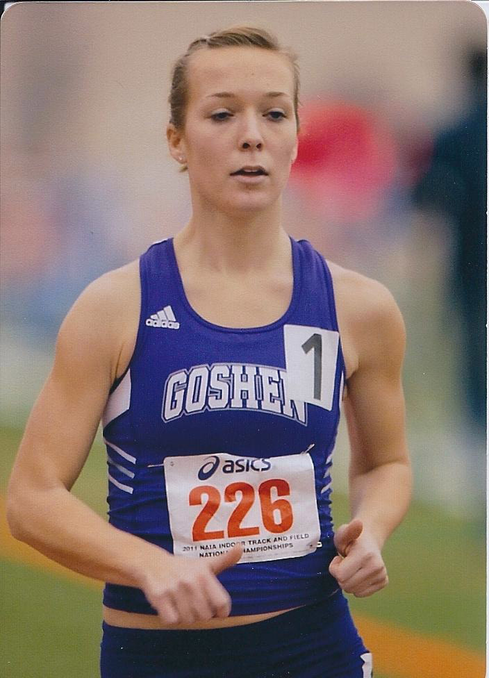 """Erin Helmuth participates in the 3K race walk. She is wearing a purple Goshen jersey and the number """"226"""""""