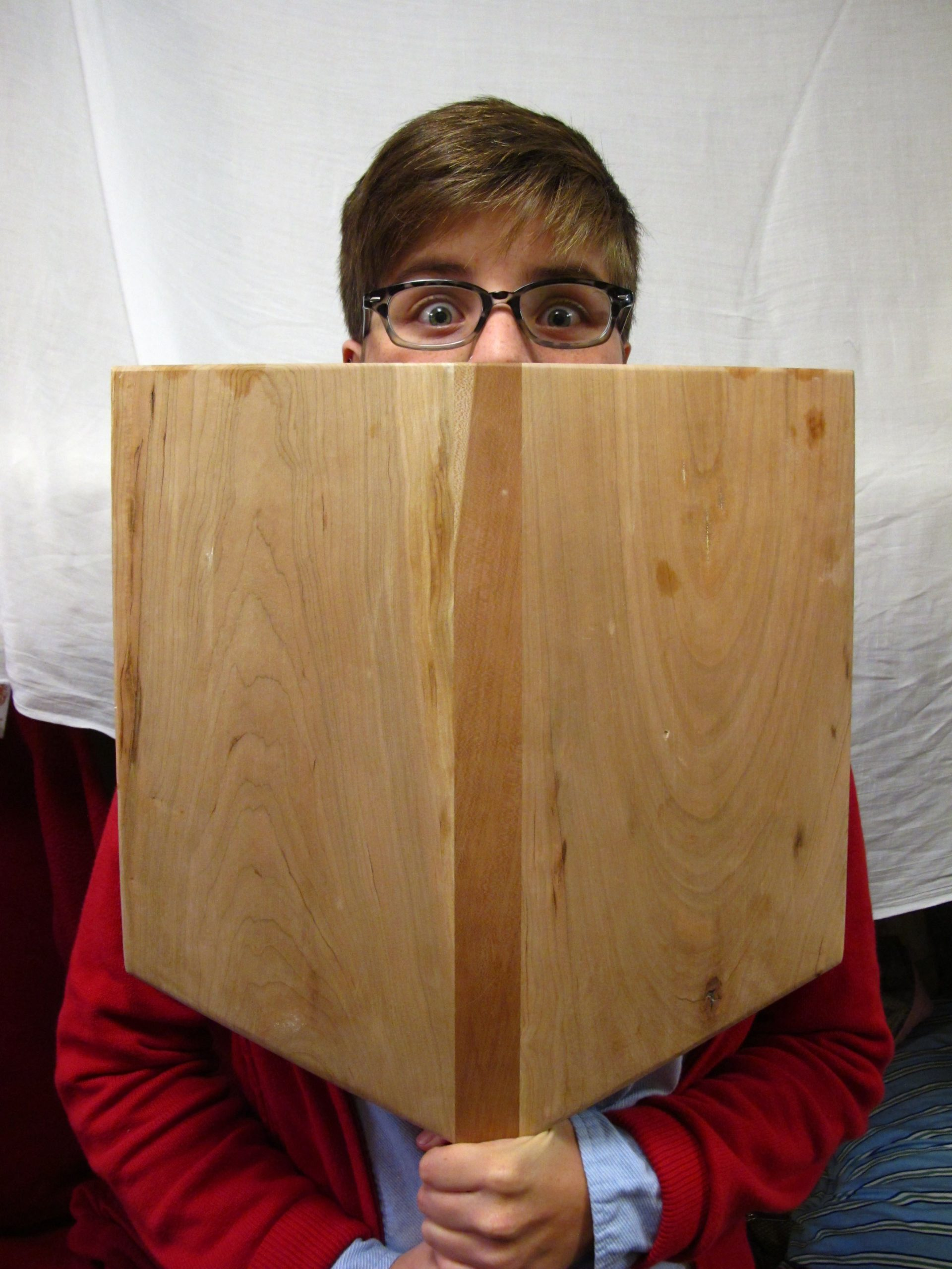 Jess Sprunger poses for a photo with her handmade wooden pizza peel