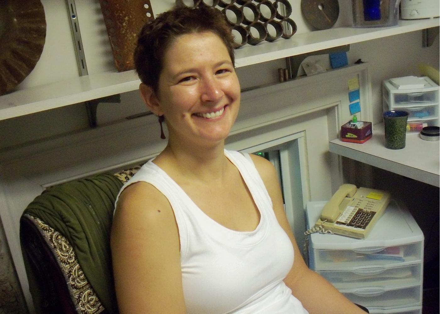 Kristi Glick smiles for a picture in her studio