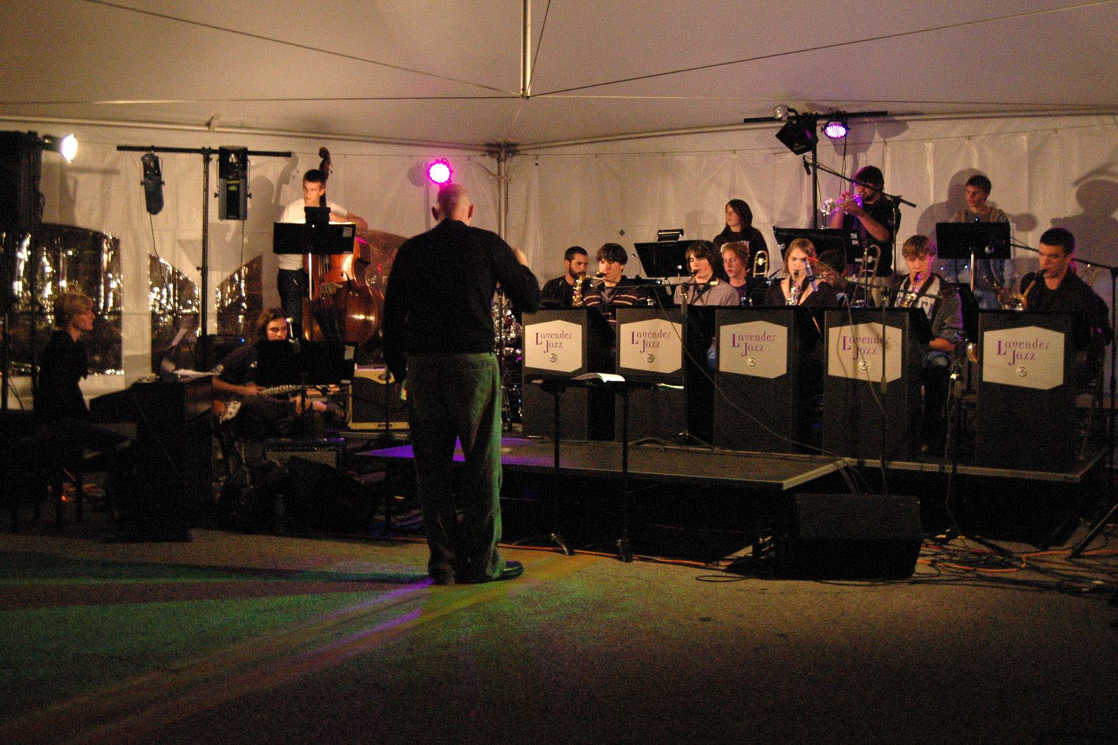 Lavender Jazz performs in a tent for First Friday