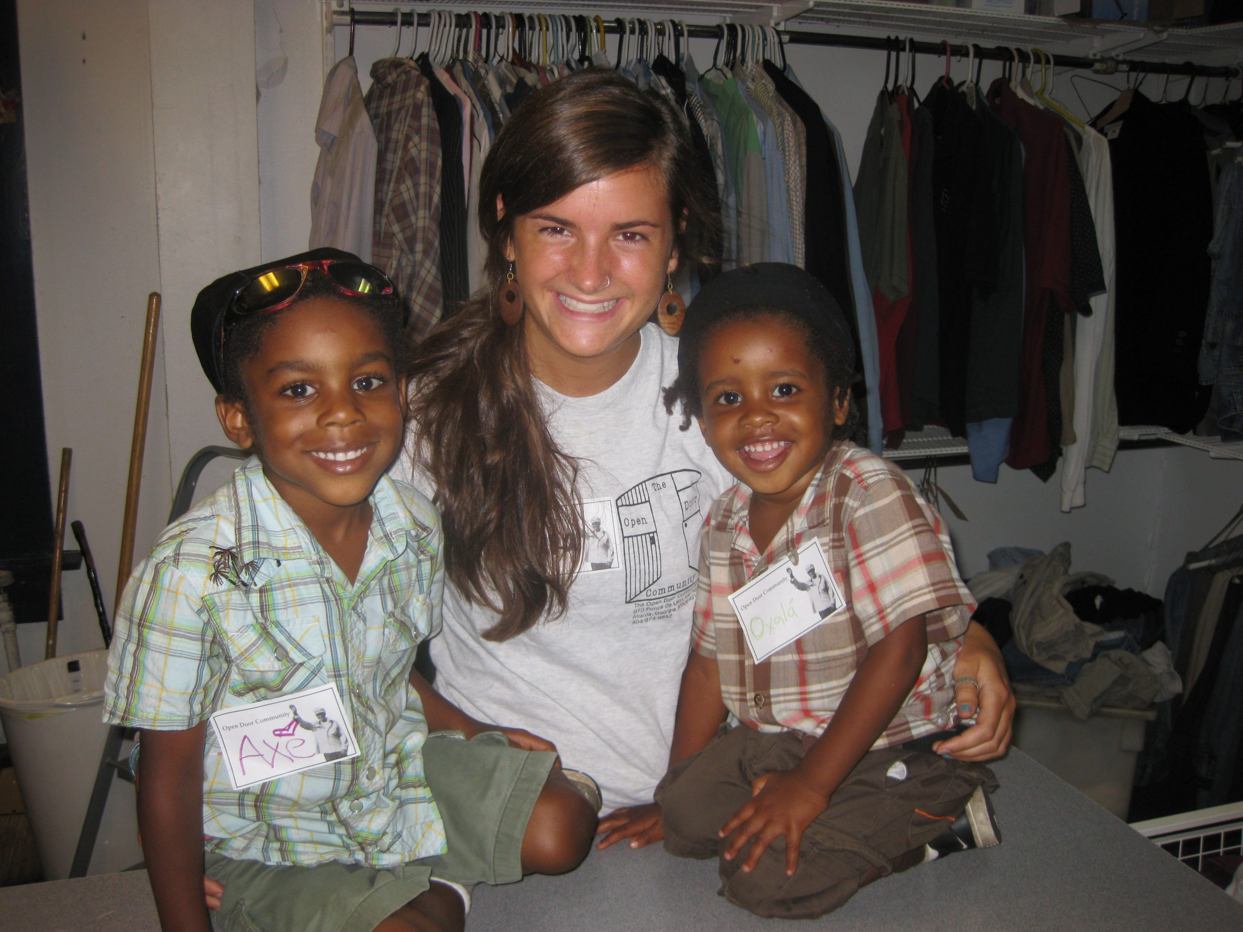 Mara Weaver poses for a picture with two children