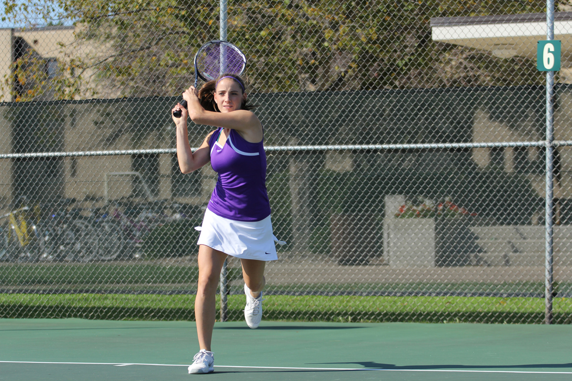 A player on the Goshen women's tennis team plays a game on the court