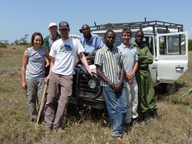 research group poses in Kenyan Savannah
