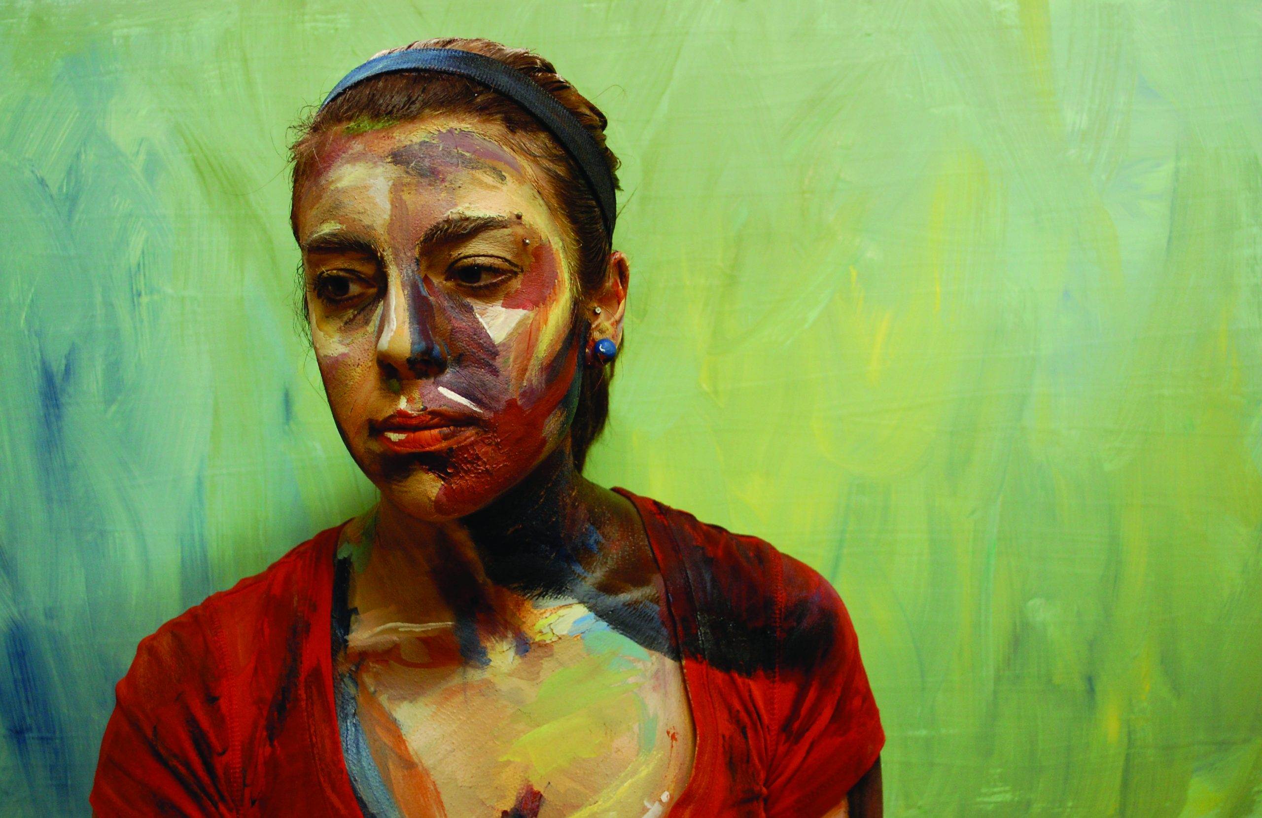 Anna Ruth and Lydia Yoder's photograph of Emma Ruth. The paint on Emma's face and body and the painted background make her appear to be a painting instead of a photograph