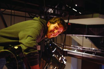 """Matt Lehman controls the lighting for a """"War of the Worlds"""" theatre production"""