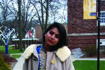 Cassilda Dhanaraj poses for a picture in a fur coat from Goodwill