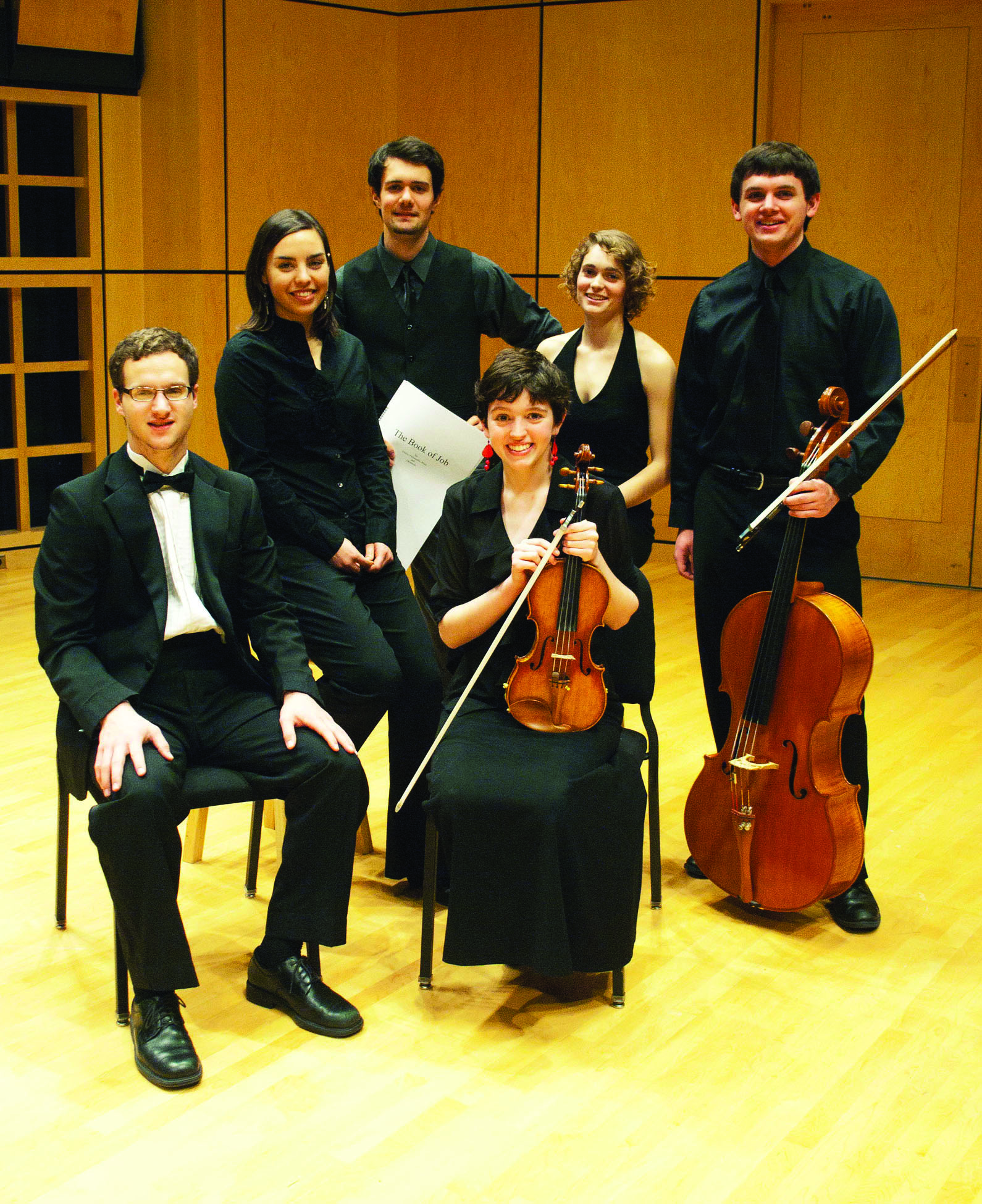 The six winners of the Concerto-Aria competition pose for a picture with their instruments in Sauder Concert Hall
