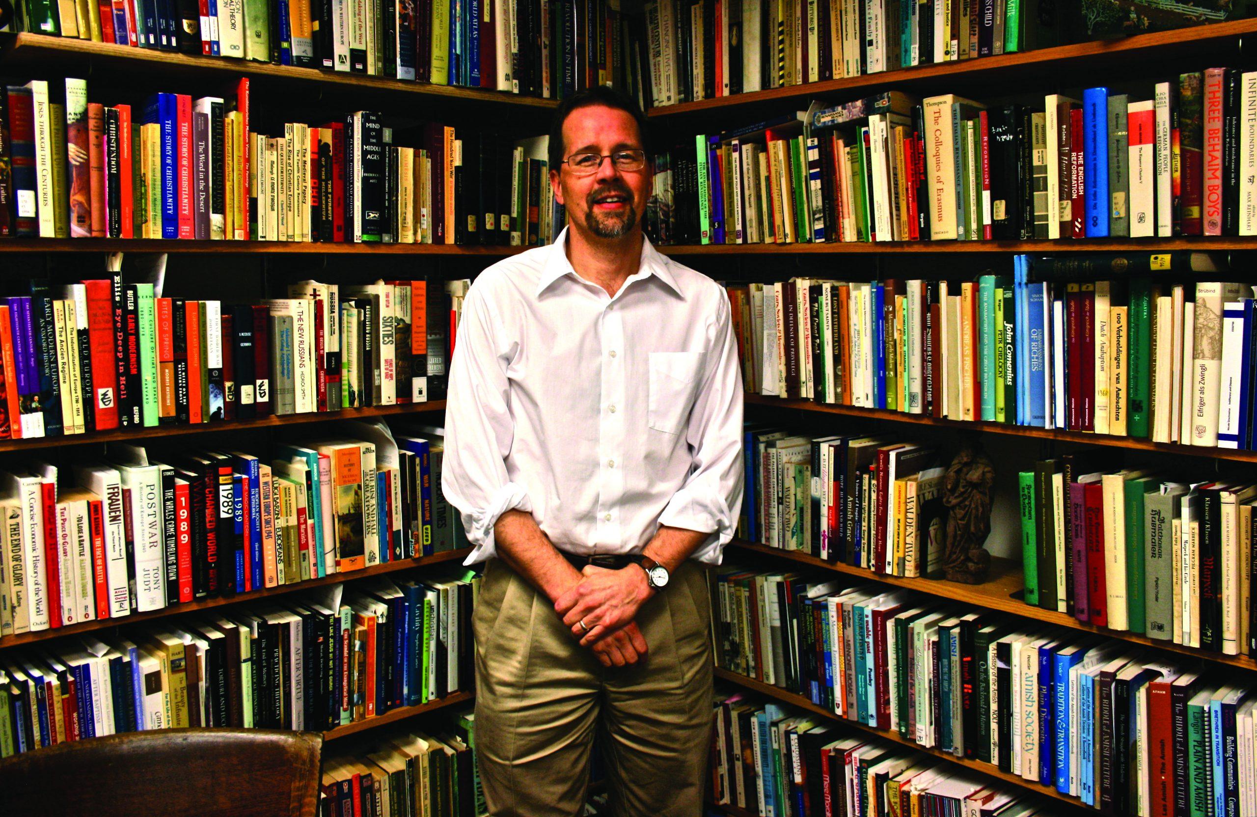 John Roth by book shelves