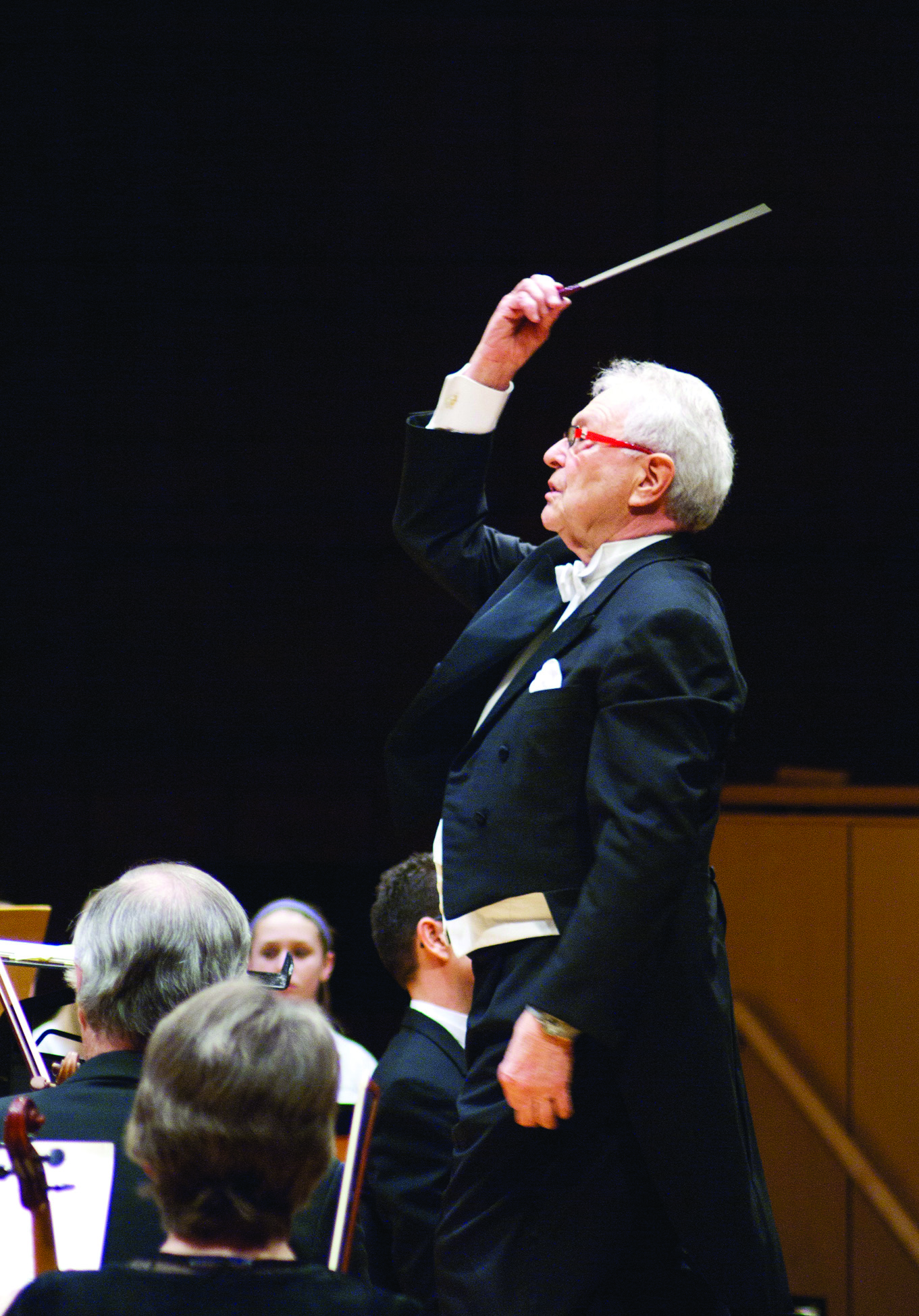 Maestro Vance George conducting with a baton