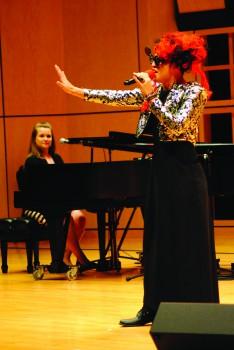 student sings at kickoff