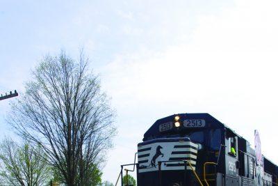 train drives through campus
