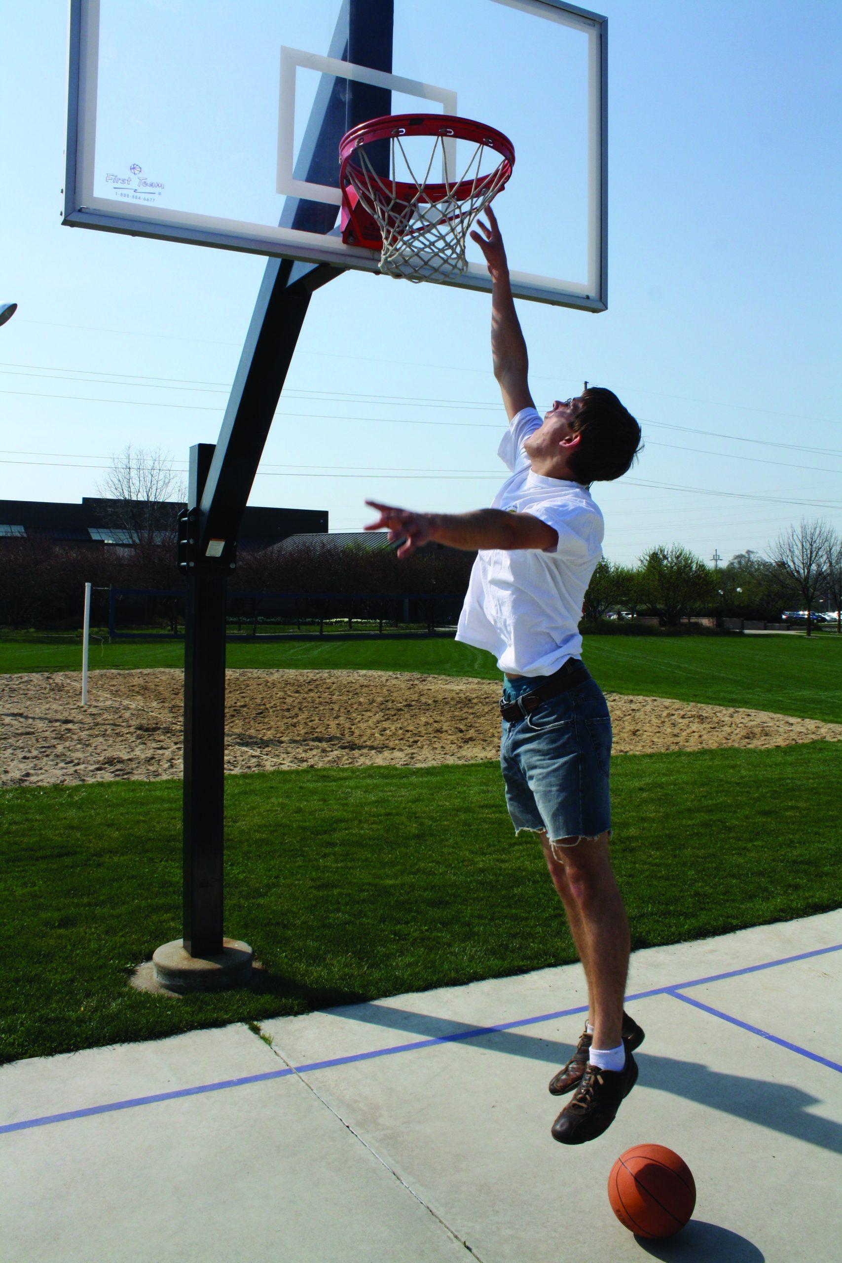 Nate Day dunks a basketball