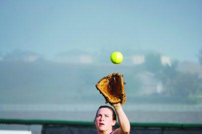 player catching softball