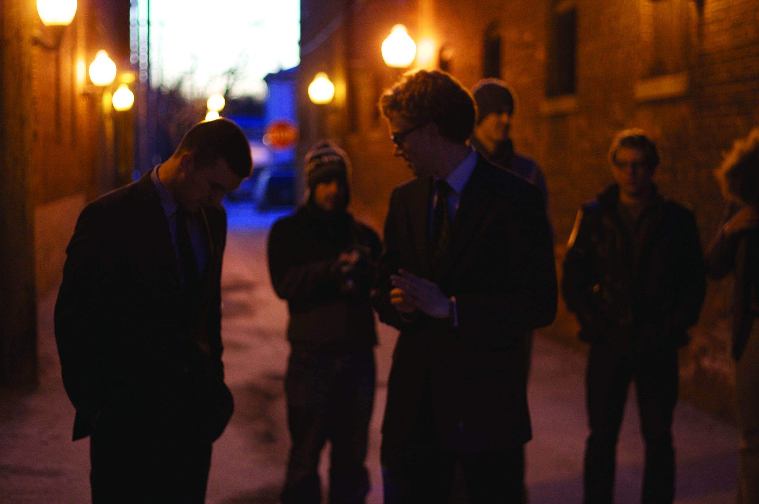 Photo of David Harnish and Abe Pauls in downtown Goshen at night