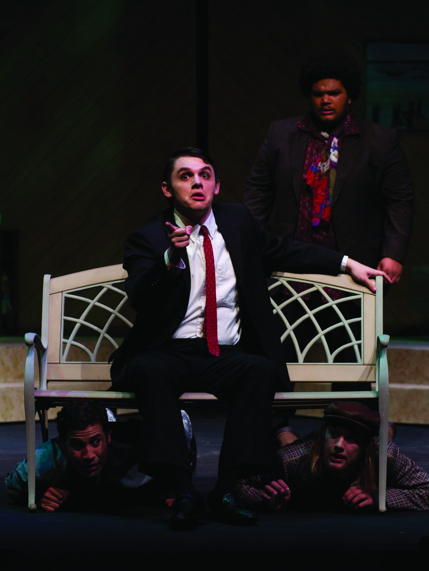 An actor sits on a bench on the Umble Center stage during a performance of Twelfth Night