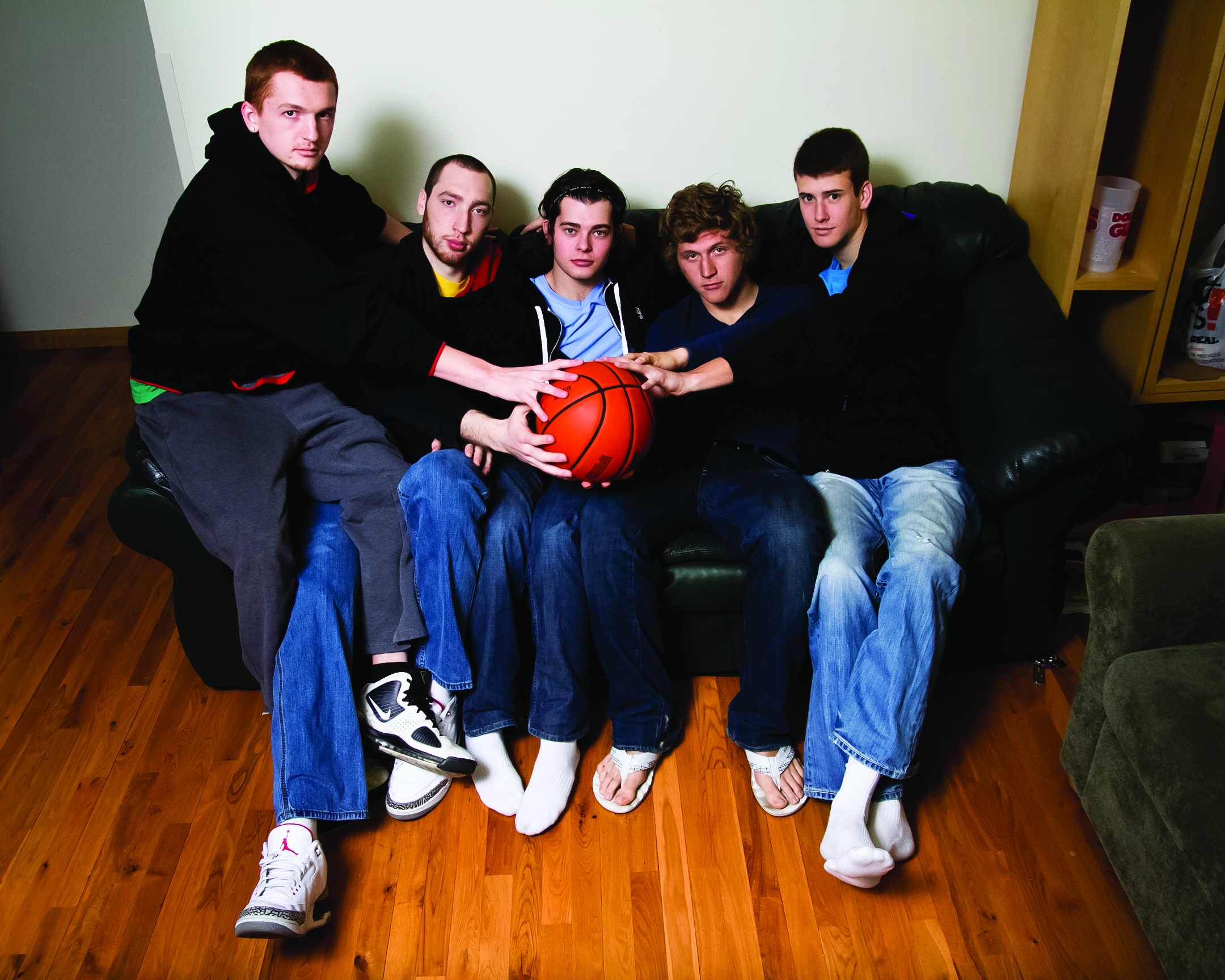 Basketball players on a couch
