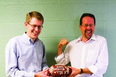 "Professors Steven Nolt and John Roth hold the famed ""Battle for Wyse 3"" football"