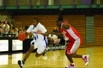 Wearing his Goshen College jersey, Errick McCollum dribbles the ball down the court in the RFC and keeps a player from an opposing team away