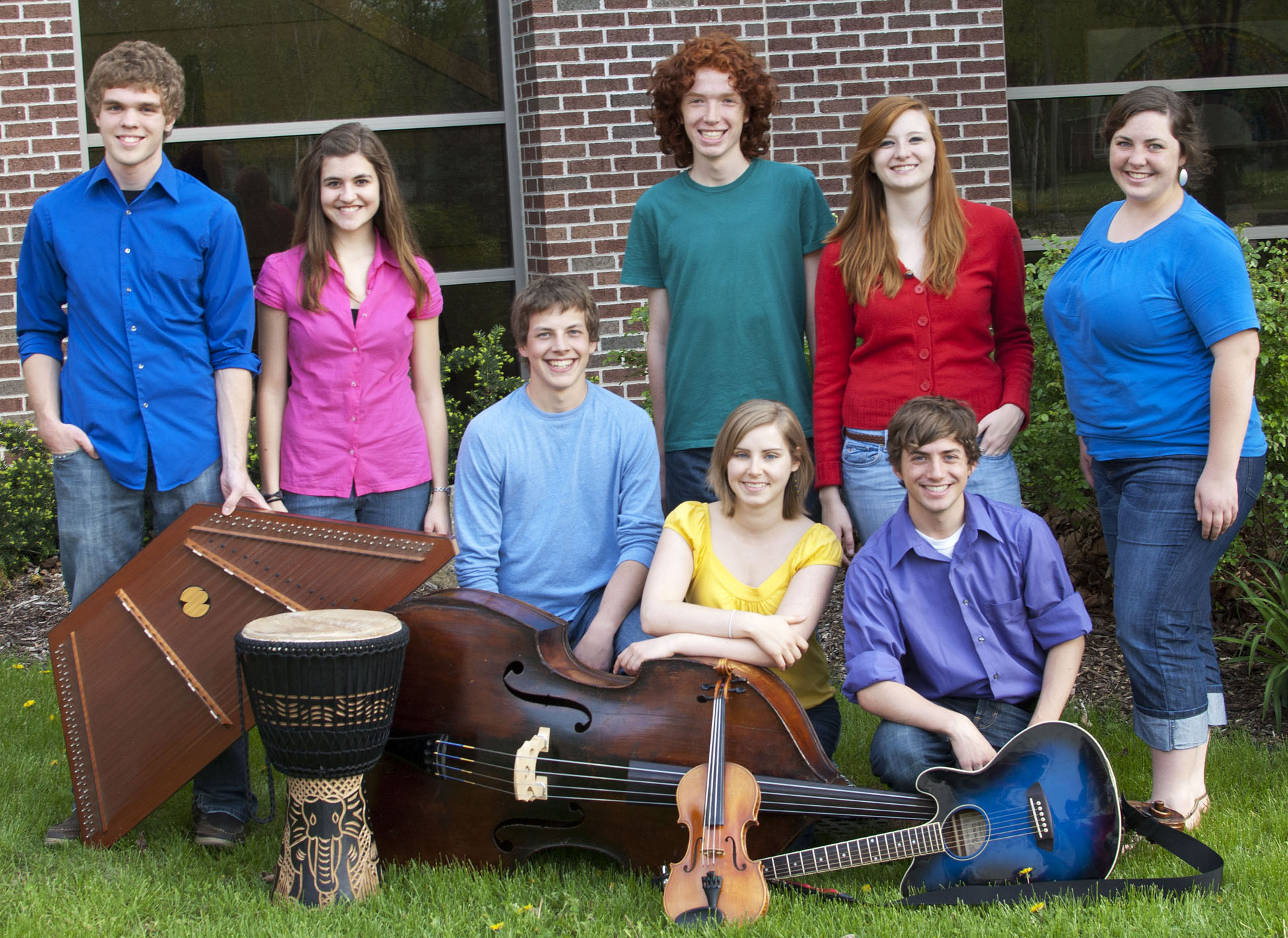 Members of Parables pose for a picture with their instruments outside the Music Center