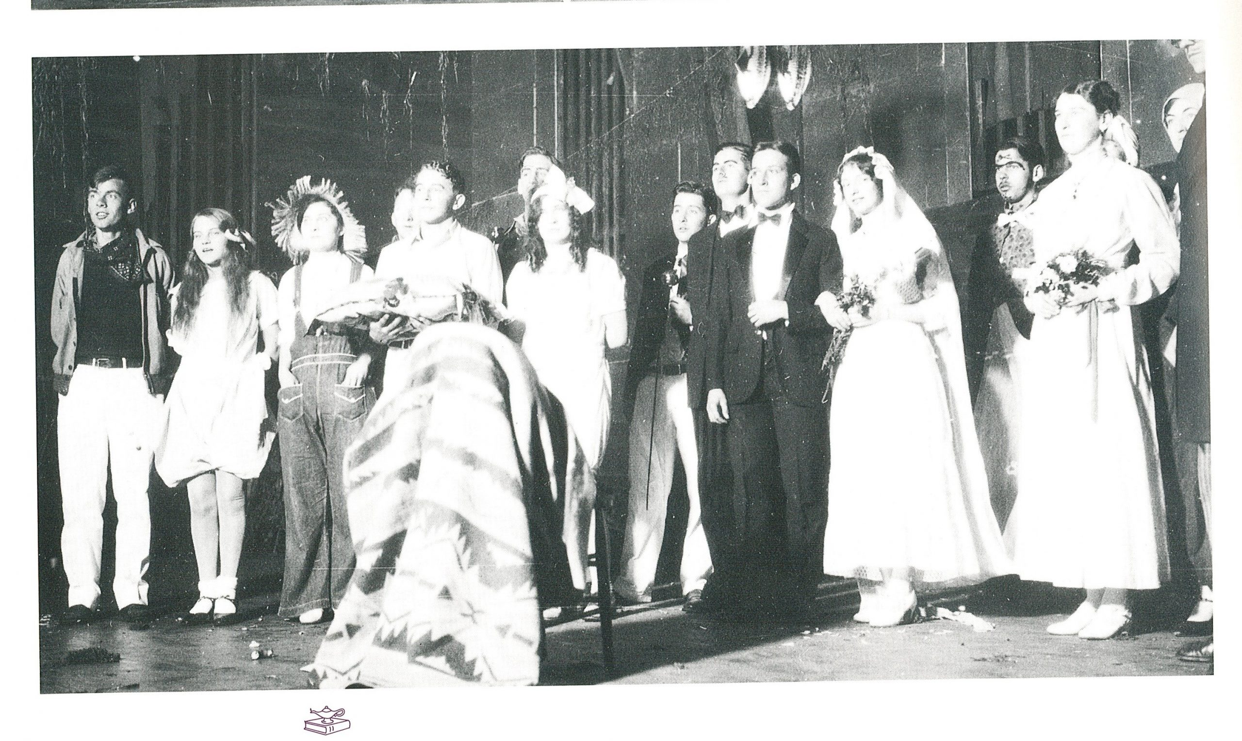 Students pose in costume for a mock wedding at a 1930 Goshen College Halloween costume party