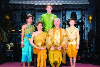 The Graber Miller family poses for a picture in traditional Cambodian dress
