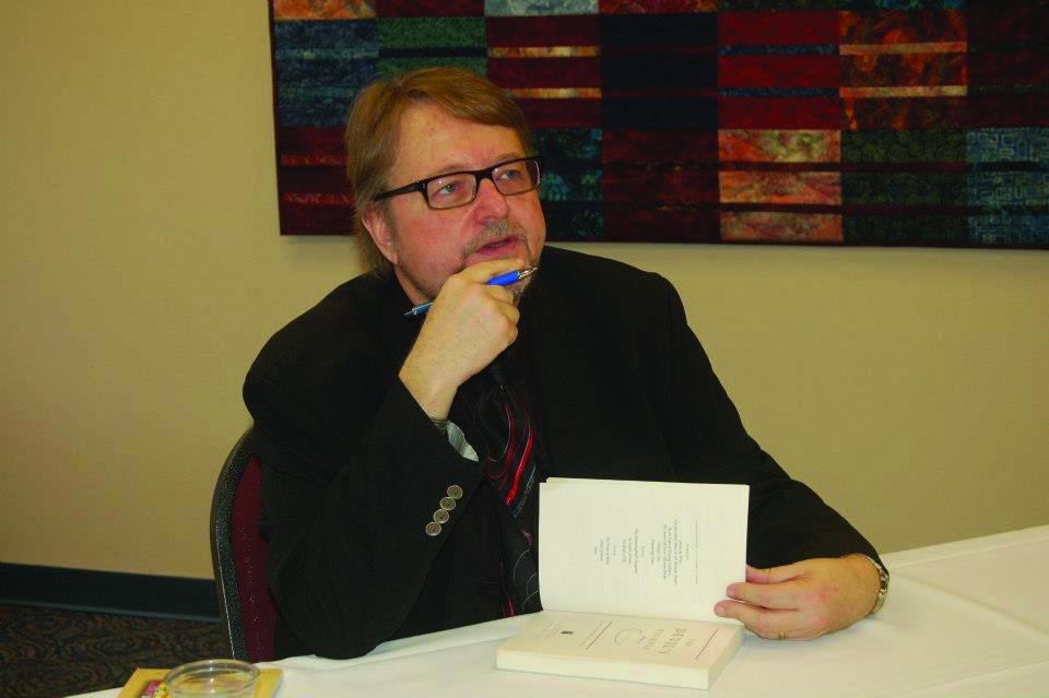 Luis Urrea at a book signing