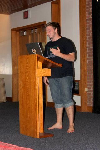 Ammon Allen-Doucot reads his poetry at a poetry slam