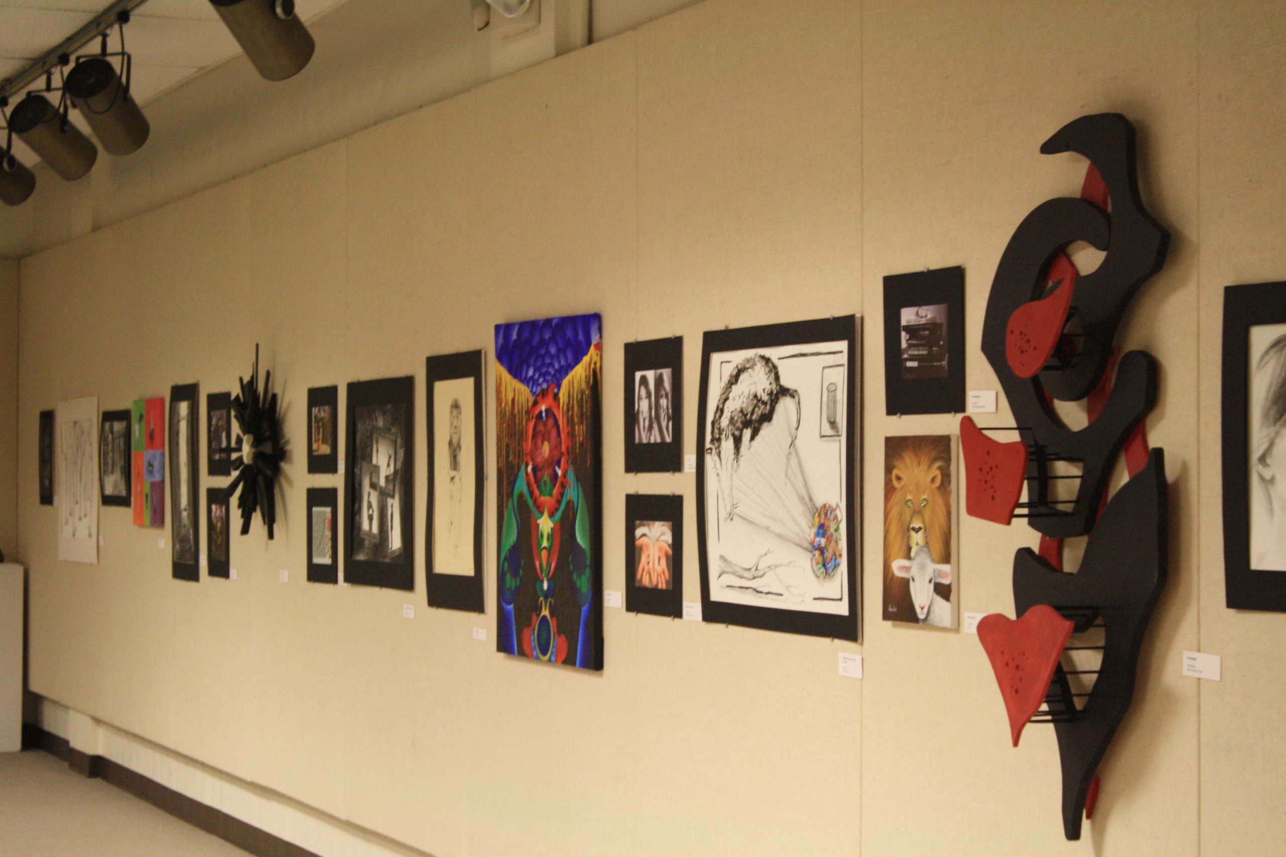"""Students' """"Lion and Lamb"""" artwork hangs in the Good Library Gallery"""