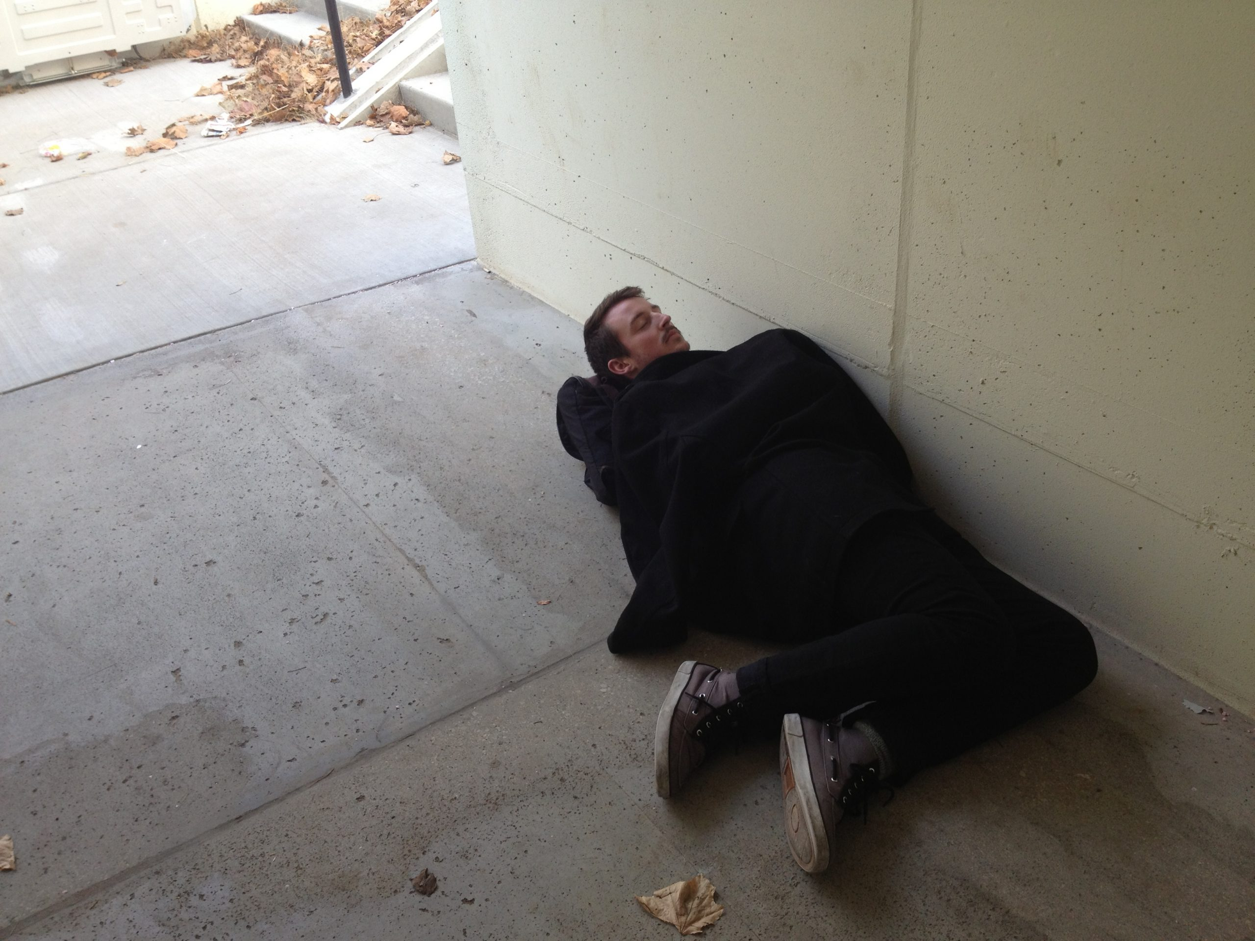 Student laying in underpass