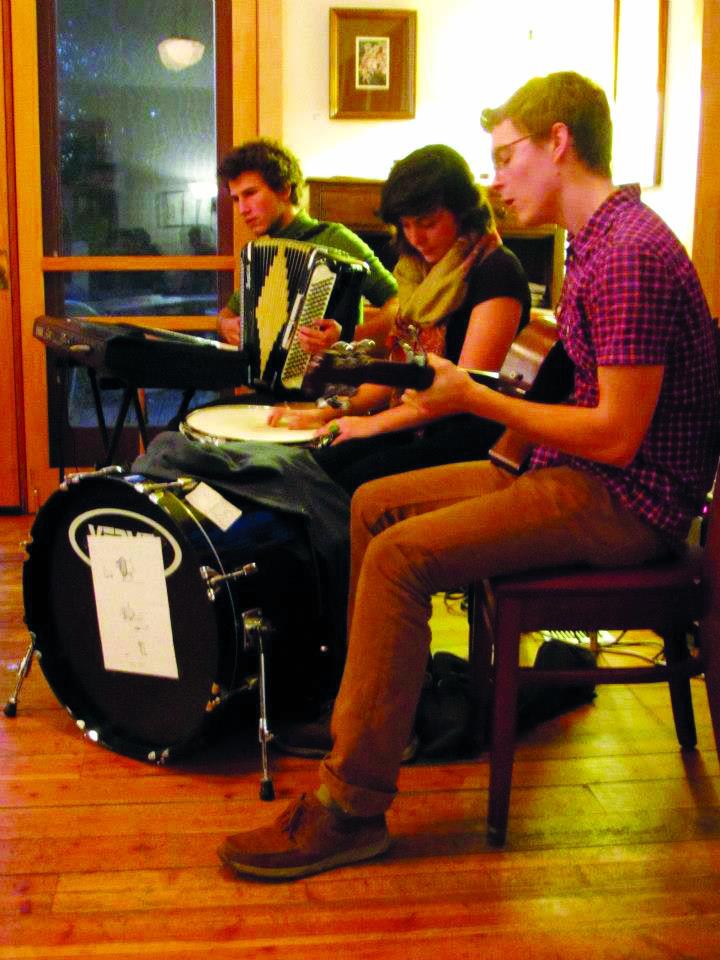 Phil Scott plays guitar alongside his two fellow Moral Circus members