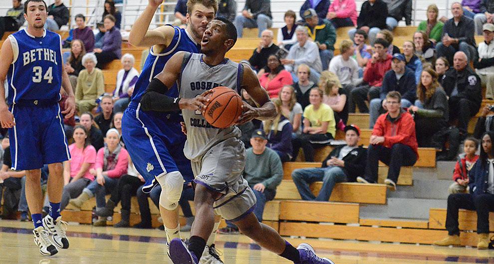 Basketball player lunging toward basket