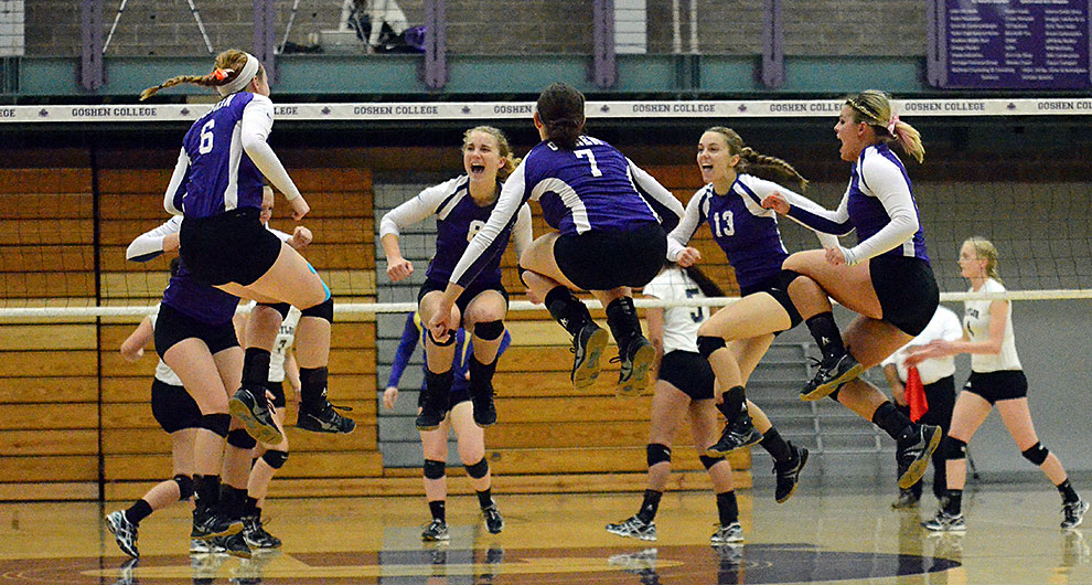 volleyball team celebrating point