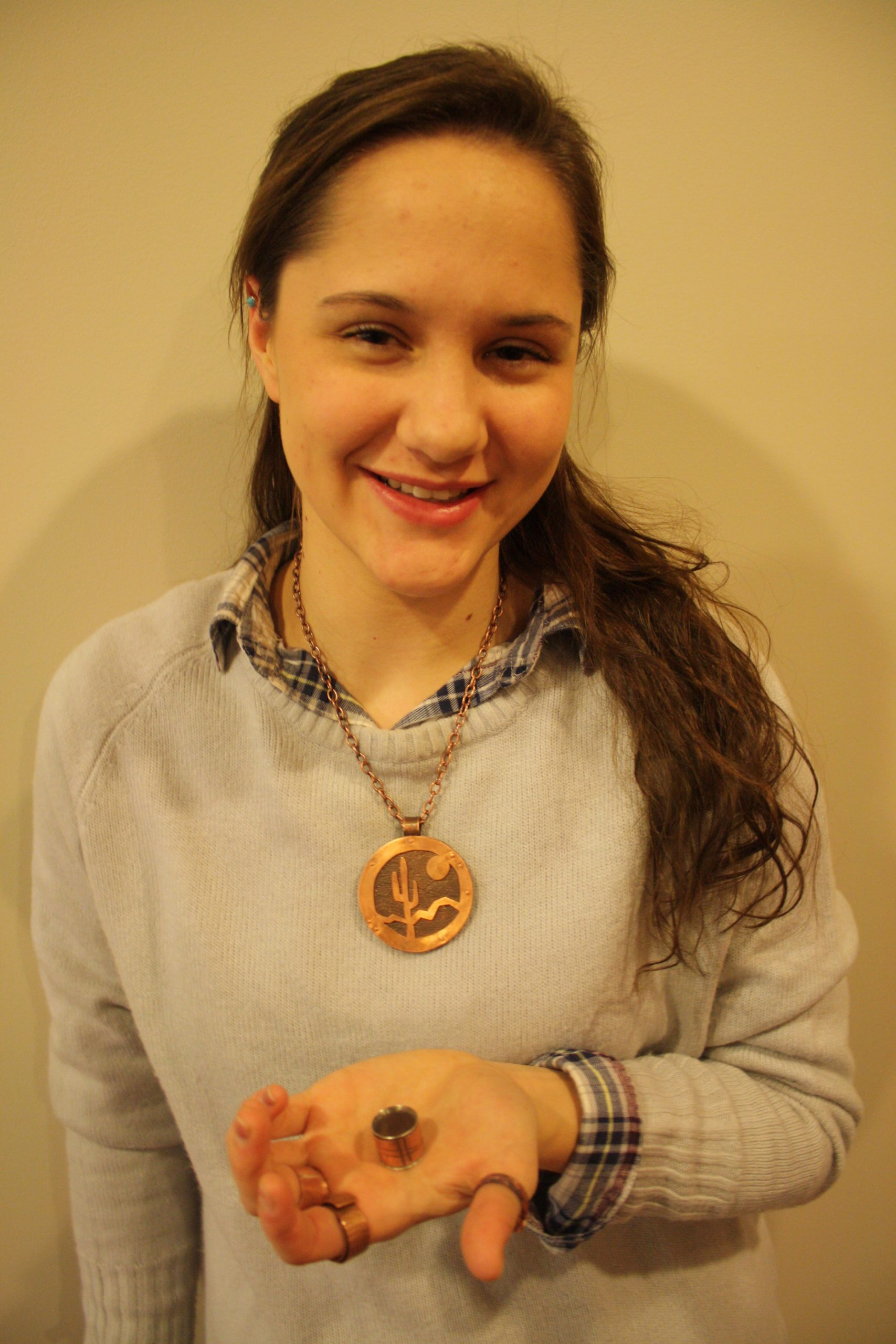 Mandy Schlabach holds one of her handmade rings